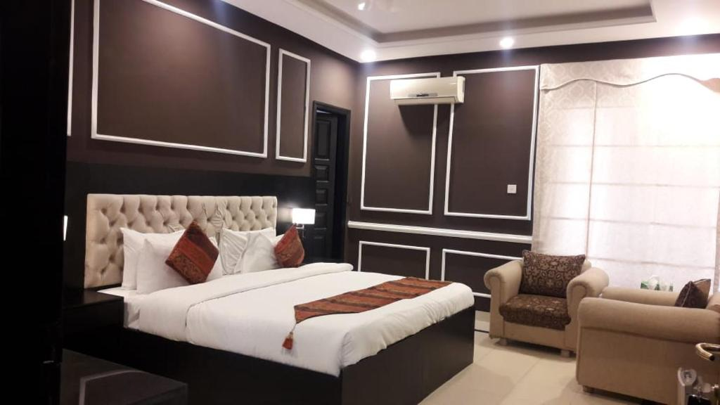 A bed or beds in a room at The Riviera