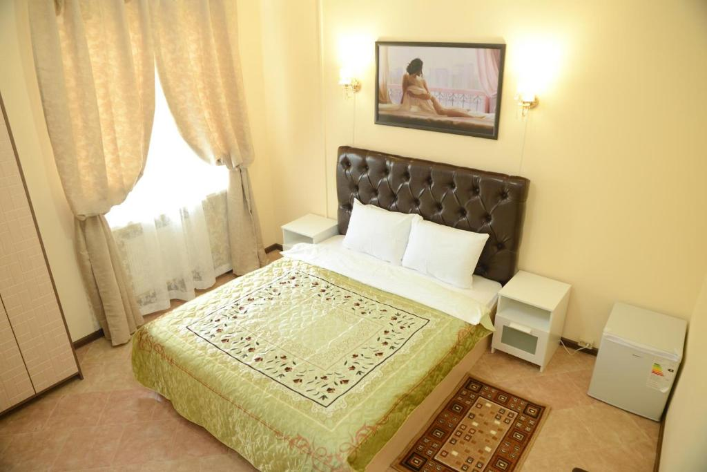 A bed or beds in a room at Sheremetievo-Transit Hotel
