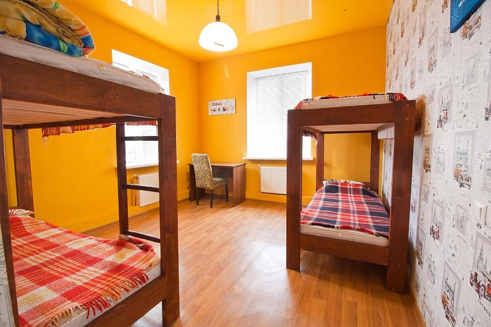 A bunk bed or bunk beds in a room at Tsentr Hostel