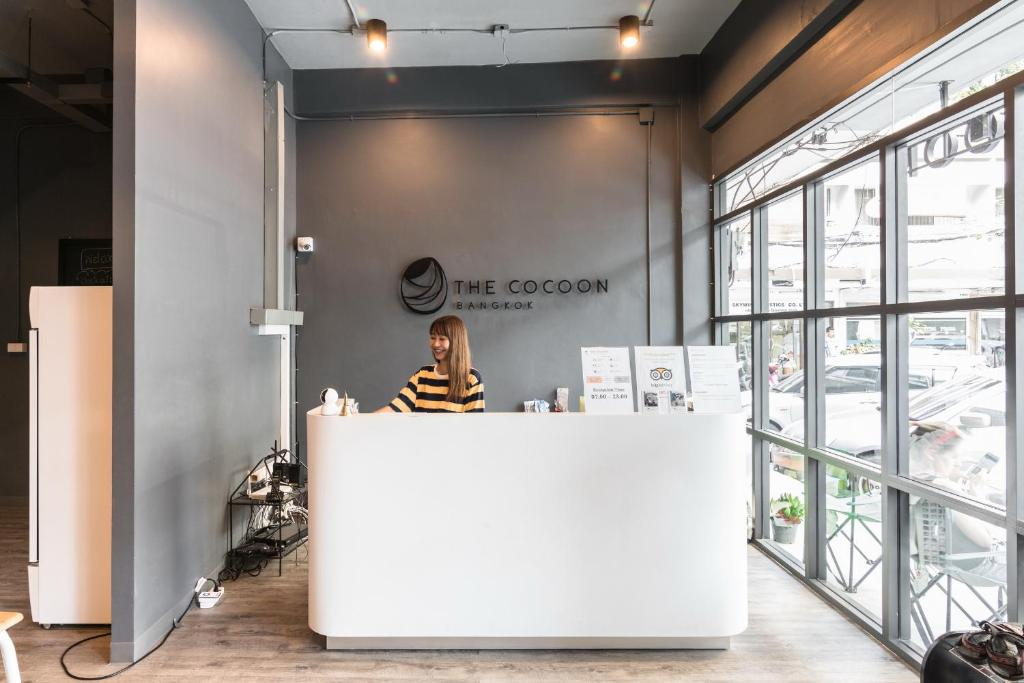 The lobby or reception area at The Cocoon Hostel