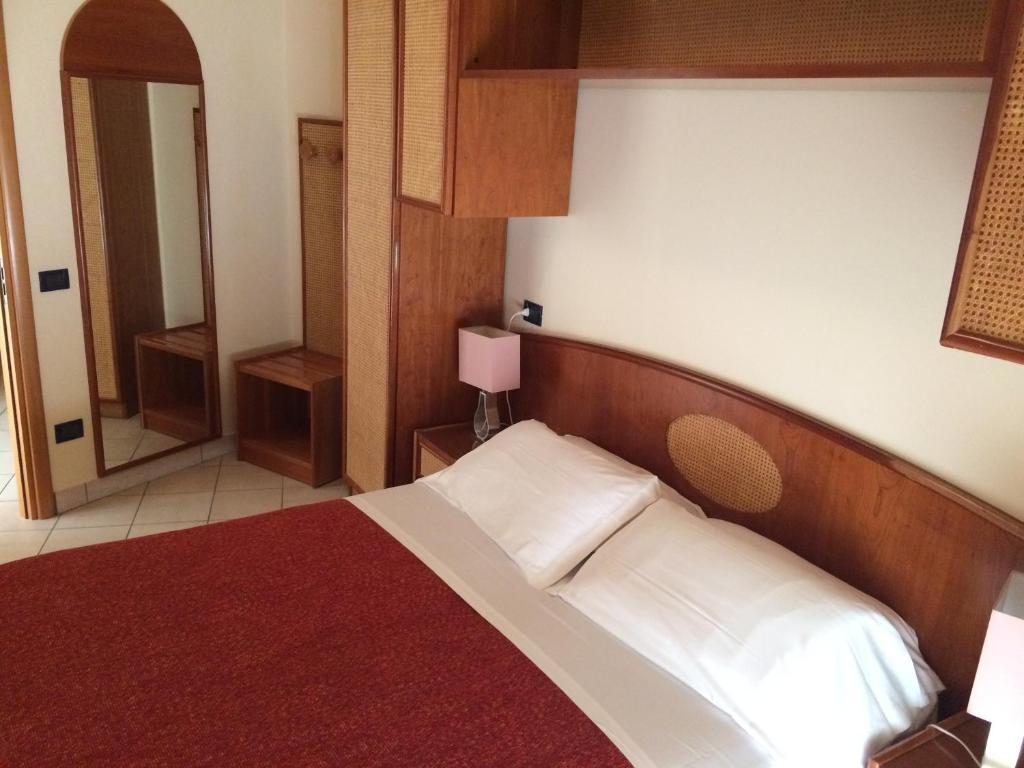 Letto o letti in una camera di Residence San Paolo