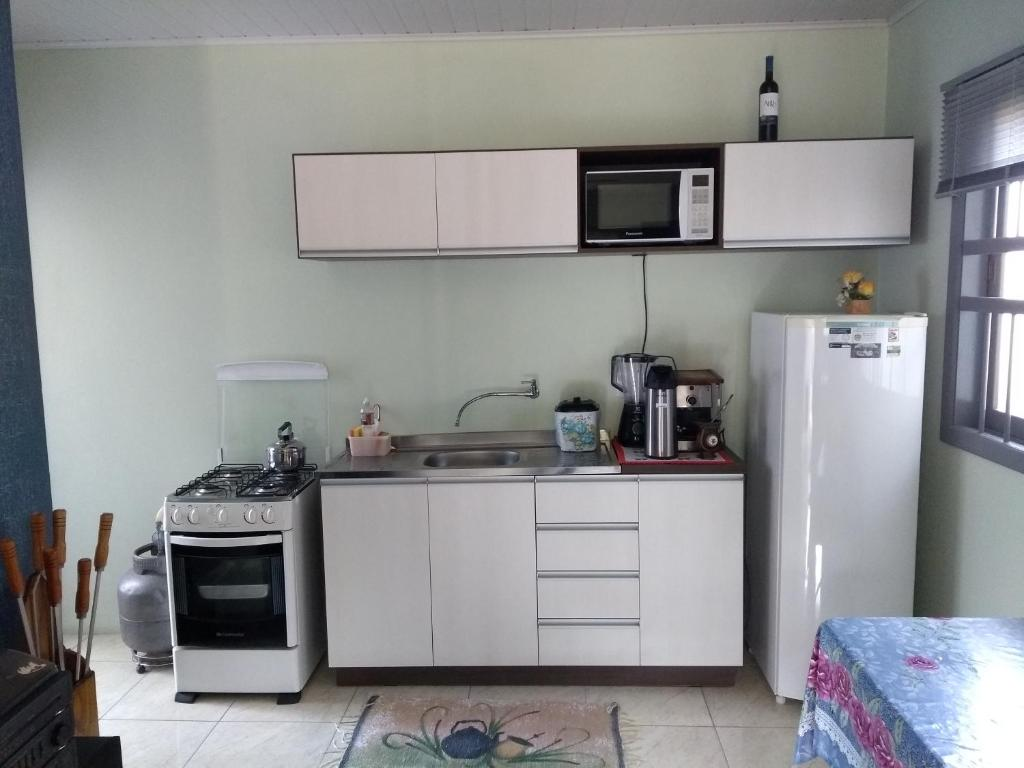 A kitchen or kitchenette at AMAZING PLACE