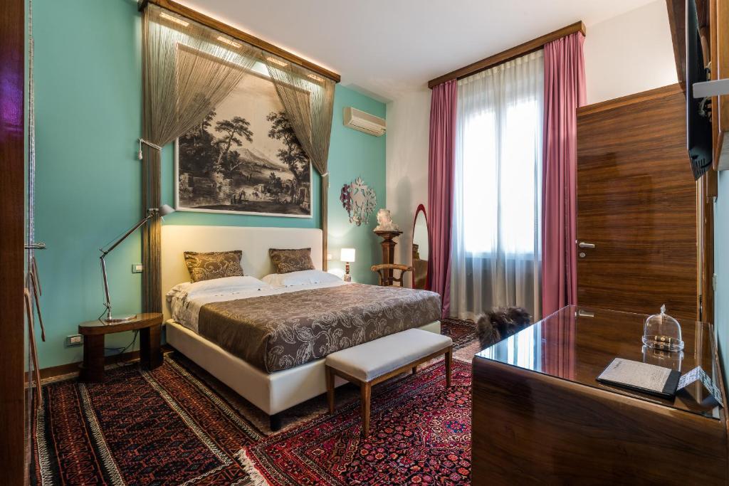 A bed or beds in a room at Casa Bertagni