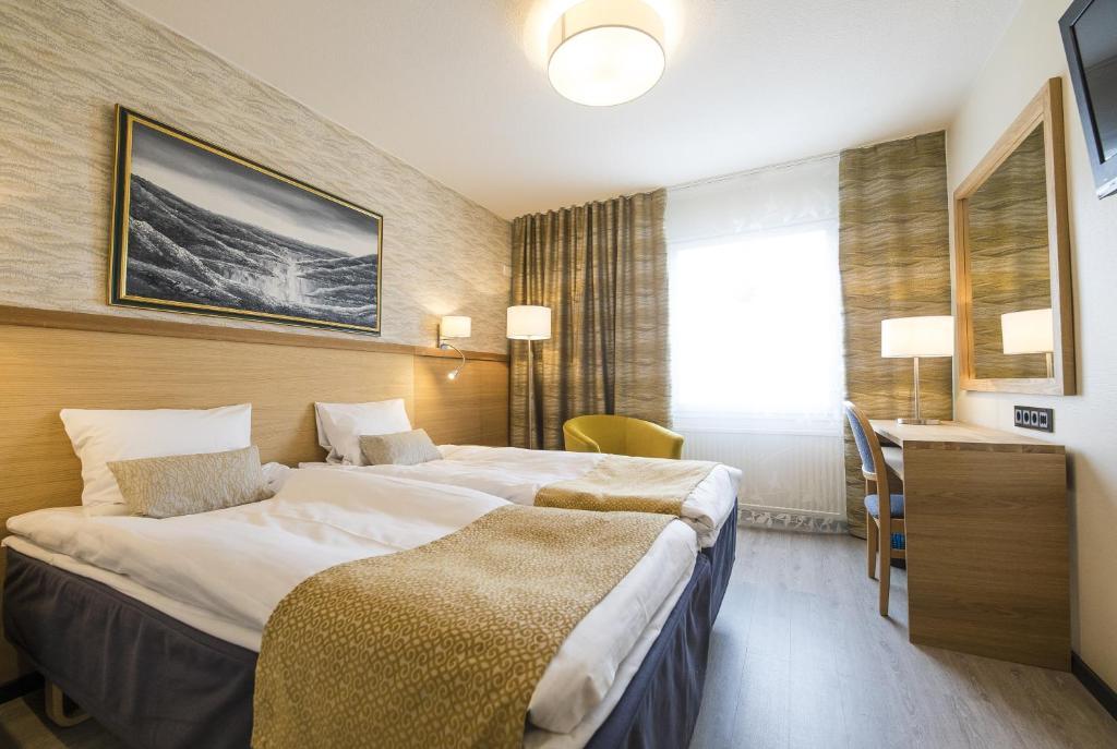 Letto o letti in una camera di Hotel Aakenus