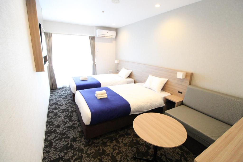 A bed or beds in a room at M-1 Tokyo Shimomaruko