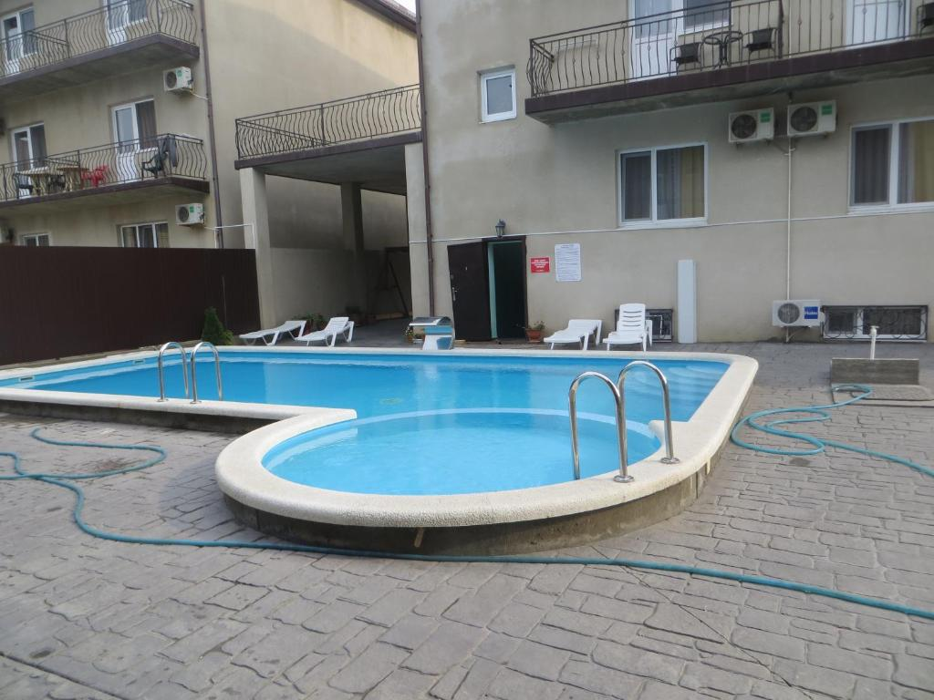 "The swimming pool at or near Гостевой дом ""Александра плюс"""