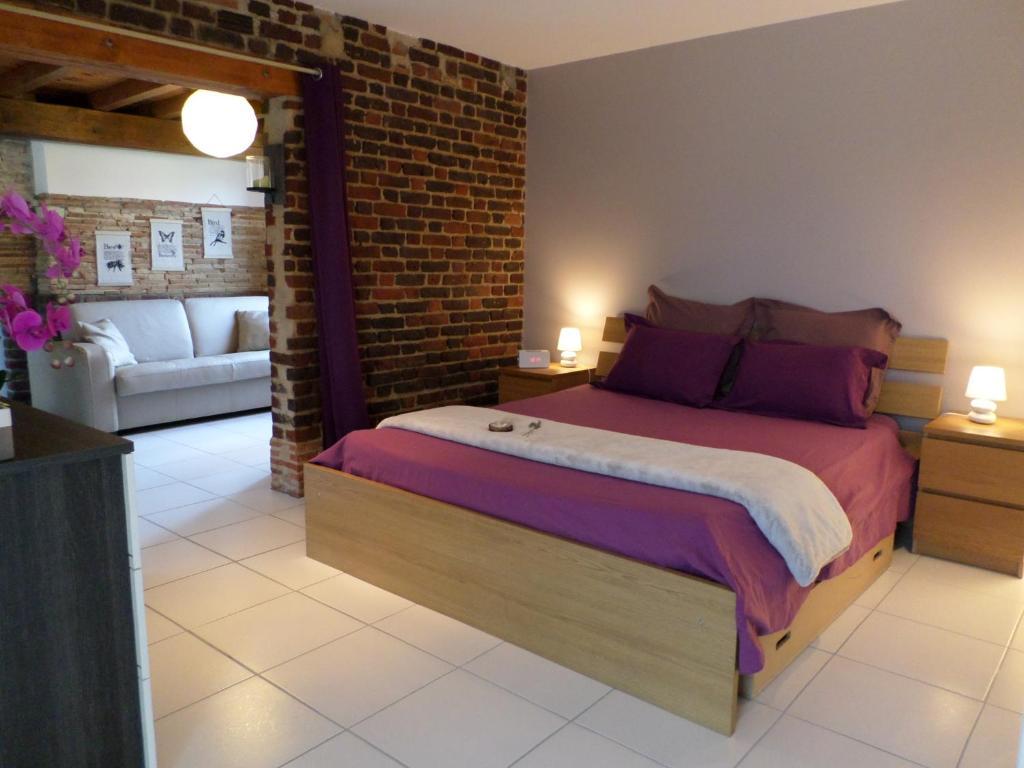 Un ou plusieurs lits dans un hébergement de l'établissement La Lavandiere Spa Jacuzzi