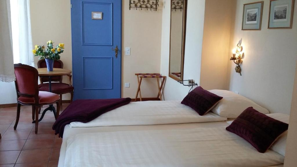 A bed or beds in a room at Casa Gialla B&B
