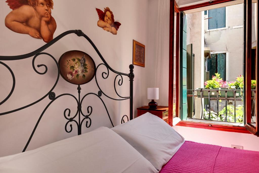 Cama ou camas em um quarto em Casa Di Sara