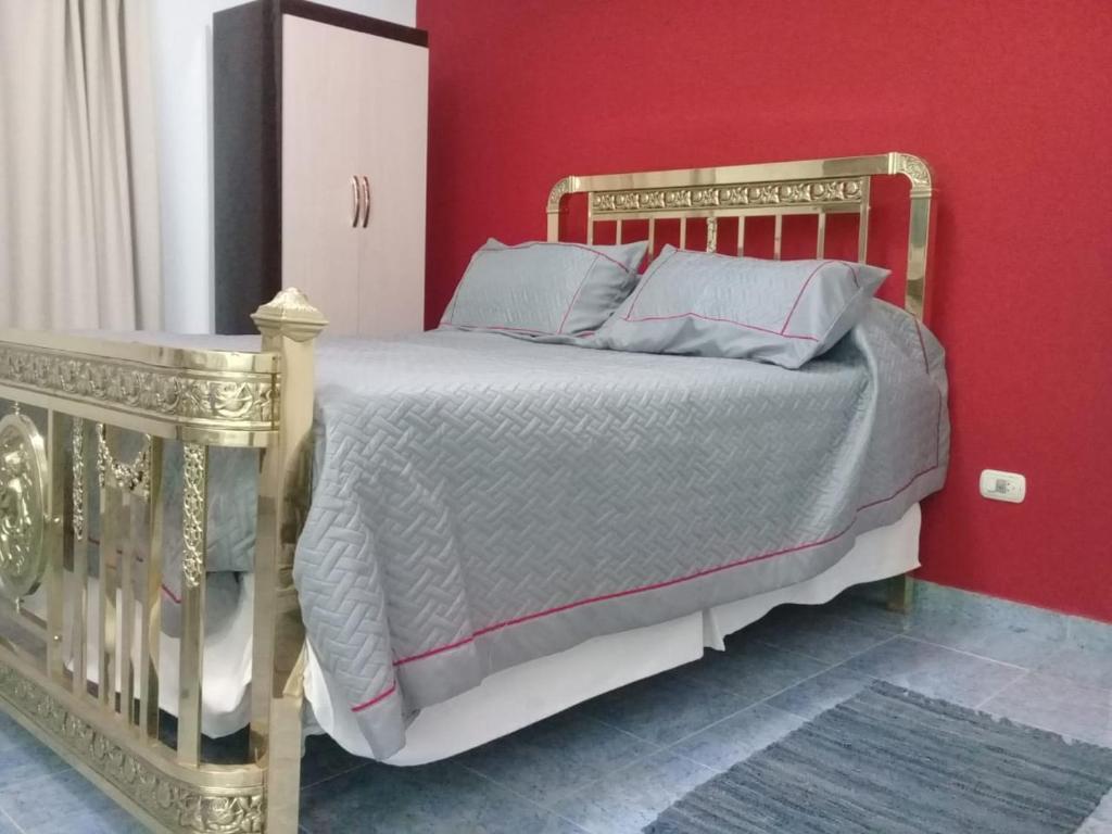 Una cama o camas en una habitación de Hostal La Terraza
