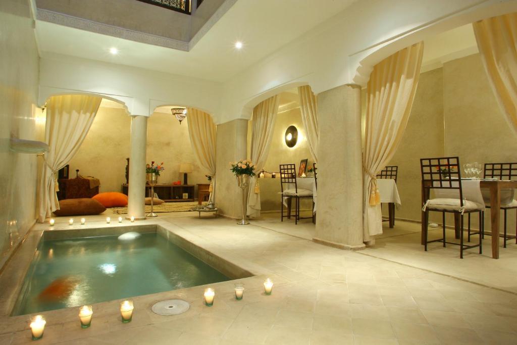 The swimming pool at or near Riad CHERRATA