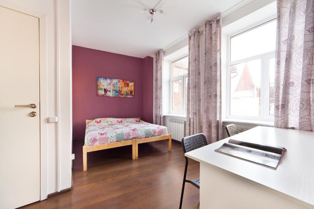 Кровать или кровати в номере Хостел Карлов Мост