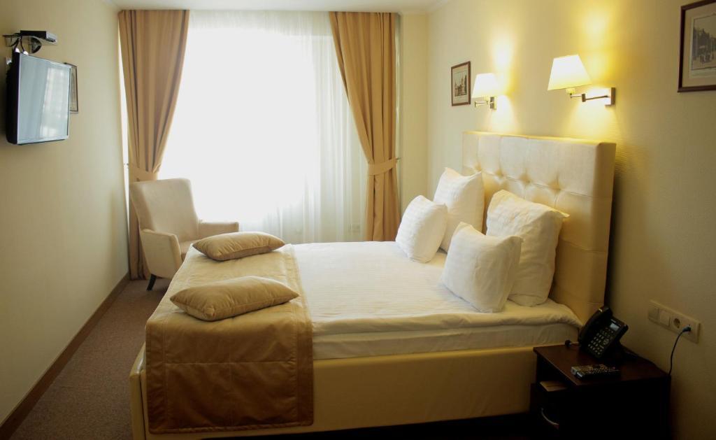 Cama o camas de una habitación en Hotel Asteri