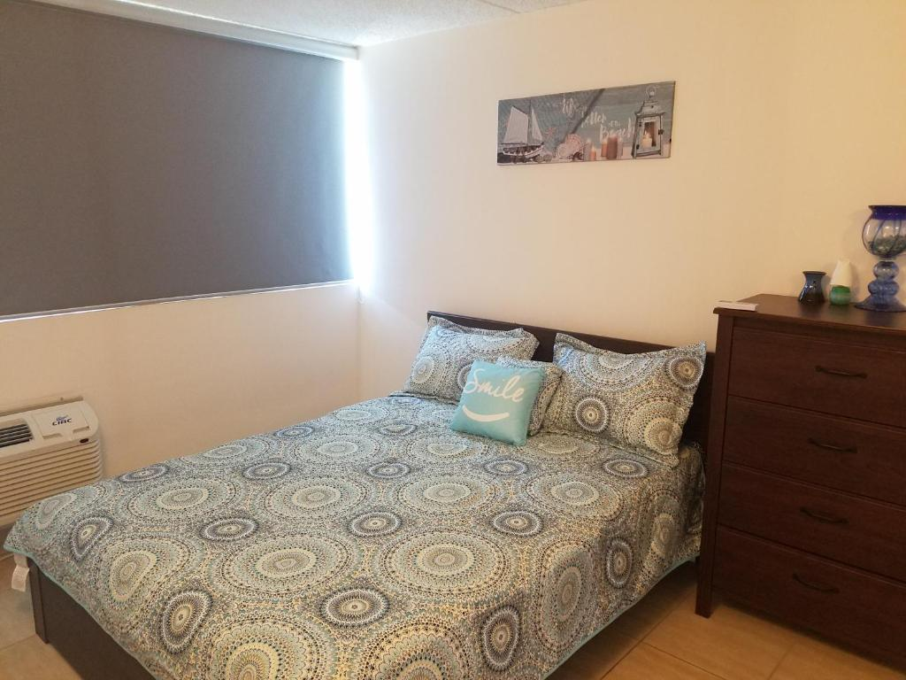 A bed or beds in a room at San Juan Condominium