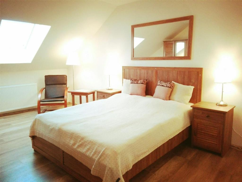 A bed or beds in a room at Chata Zdeňka Abertamy
