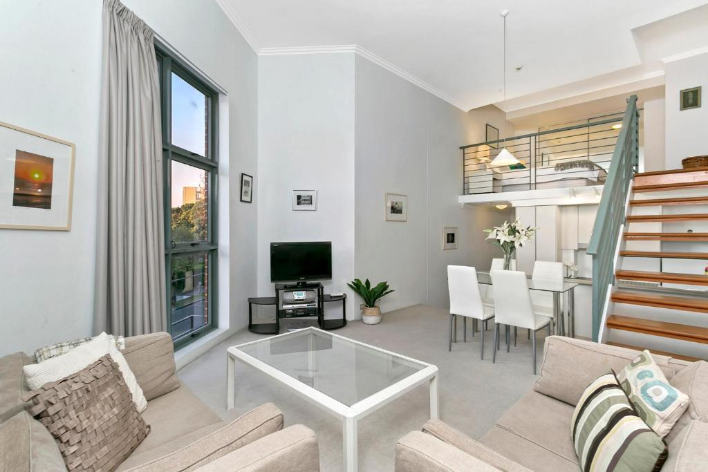 A seating area at One Bedroom Apartment Macpherson St(GA104)