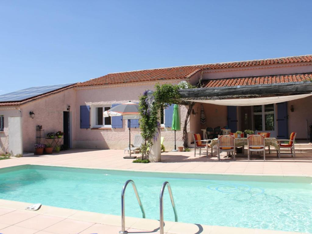 The swimming pool at or near Vibrant Villa with Private Pool in Tavernes