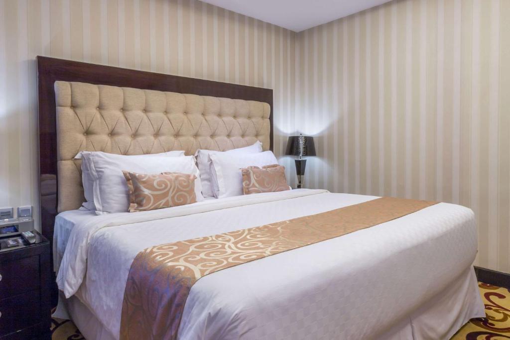 Wyndham Surabayaにあるベッド