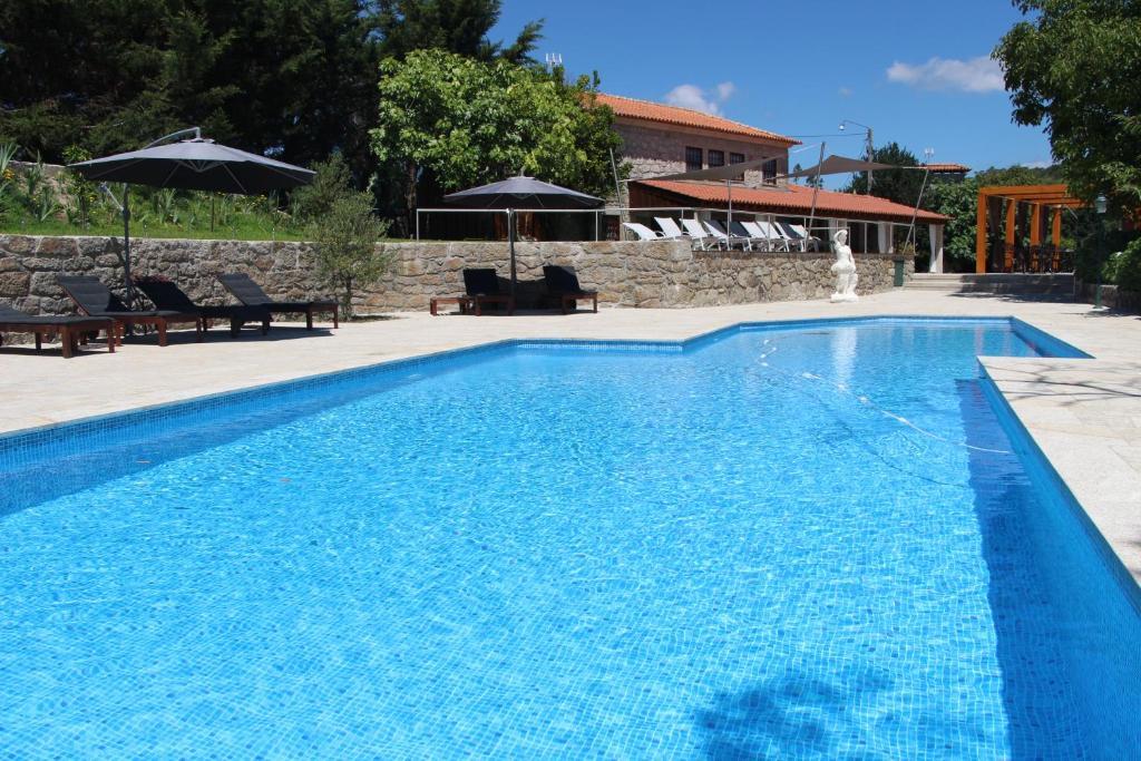A piscina em ou perto de Casas do Rio