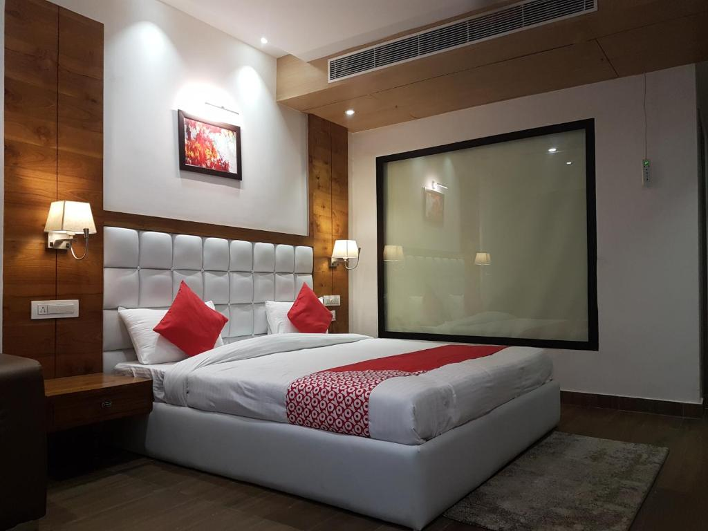 A bed or beds in a room at The Celebrations by HNH