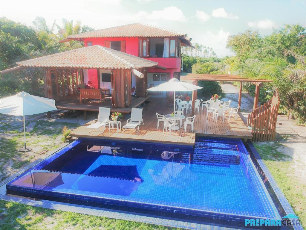 The swimming pool at or near Casa de praia em Costa do Sauípe