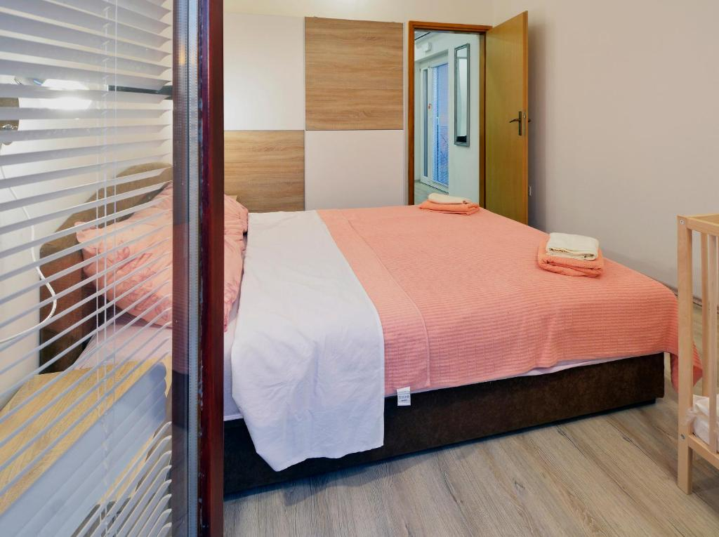 A bed or beds in a room at Dalmatian