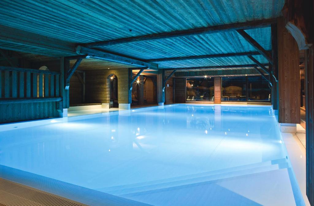 The swimming pool at or near Chalet-Hôtel La Marmotte, La Tapiaz & SPA, The Originals Relais (Hotel-Chalet de Tradition)