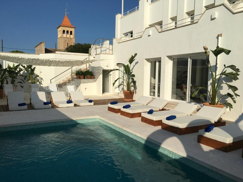 The swimming pool at or near Petit Hotel Rocamar - Adults Only