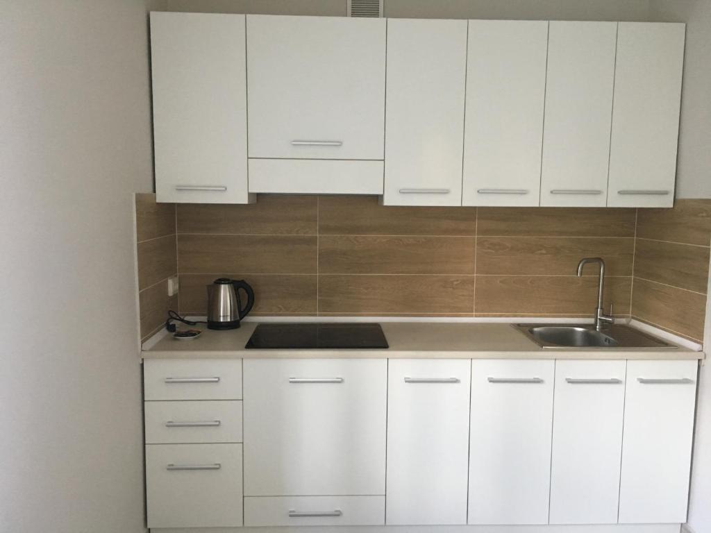 Кухня или мини-кухня в Апартаменти Рівне