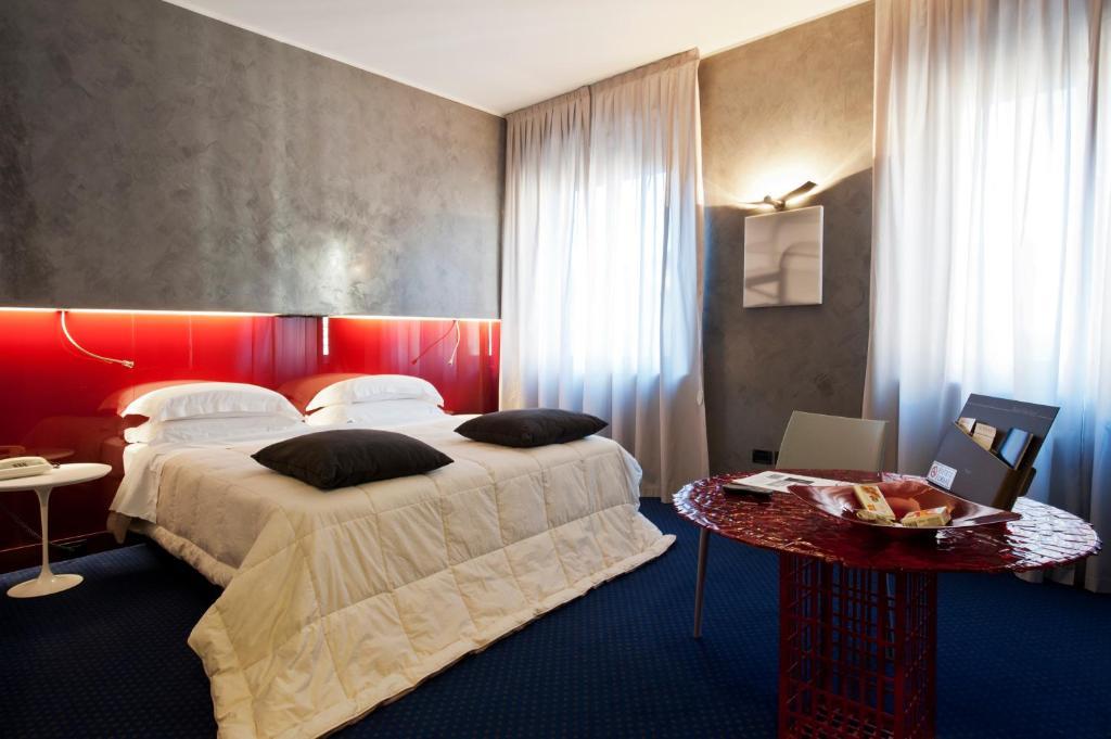 Кровать или кровати в номере Rechigi Hotel