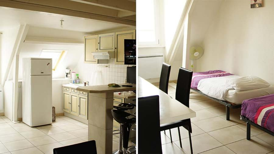 A kitchen or kitchenette at ApartHotel François 1er 14eme