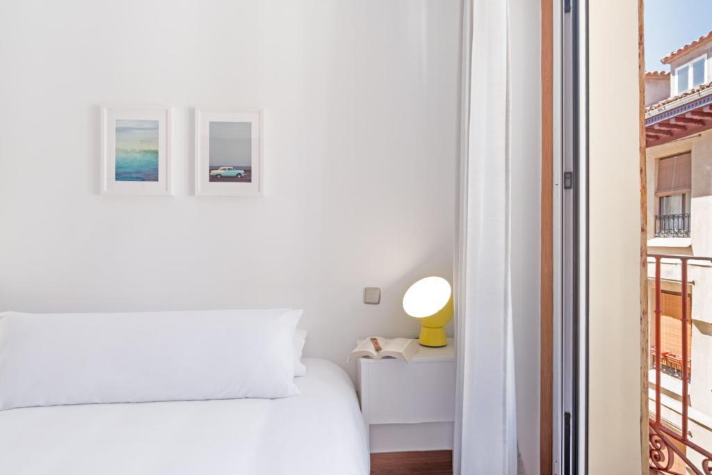 Cama o camas de una habitación en Behap Madrid De Las Letras