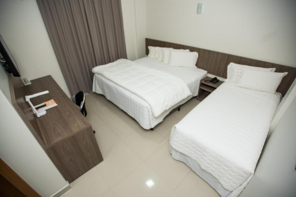 A bed or beds in a room at Sense Hotel Premium