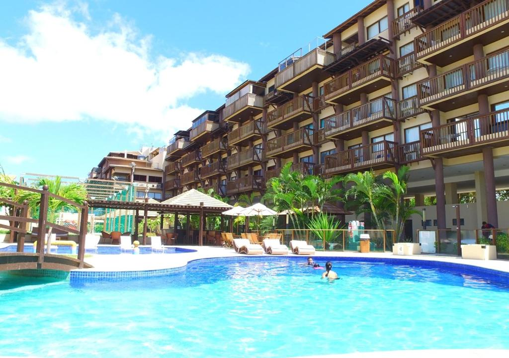 The swimming pool at or close to Excelentes apartamentos Barra Bali