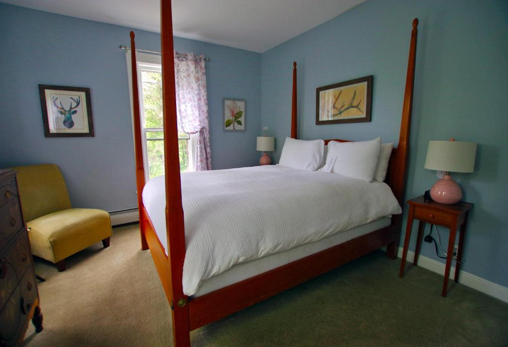 A bed or beds in a room at The Wilmington Inn