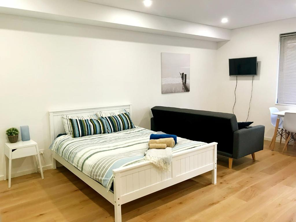 A bed or beds in a room at Darling Harbour and Fish Market: Brand New Studio