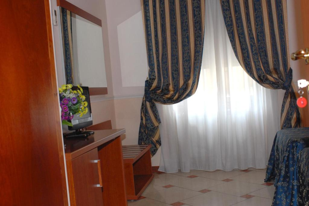 A bed or beds in a room at B&B Gerbera Roma
