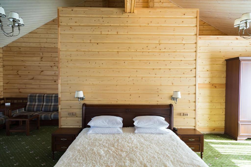 Кровать или кровати в номере VICTORIA VILLAGE
