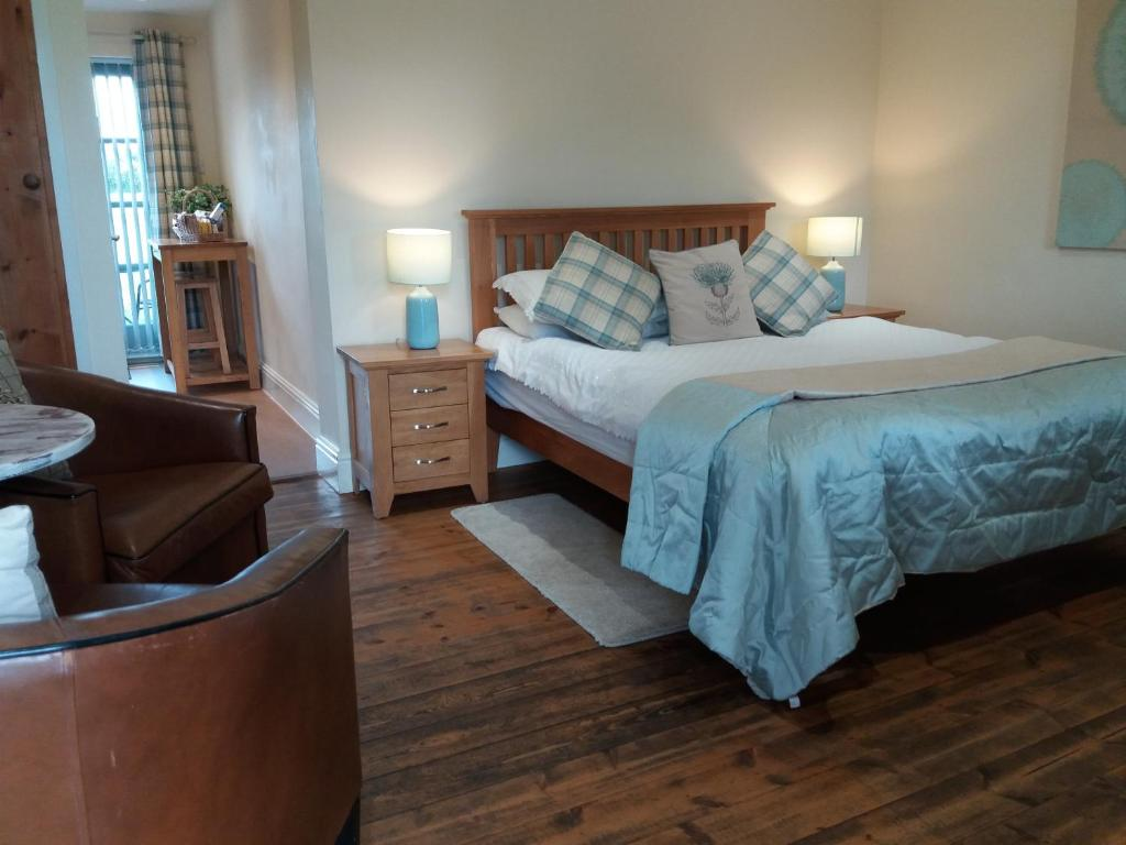 A bed or beds in a room at The Stables - Deer Park Farm