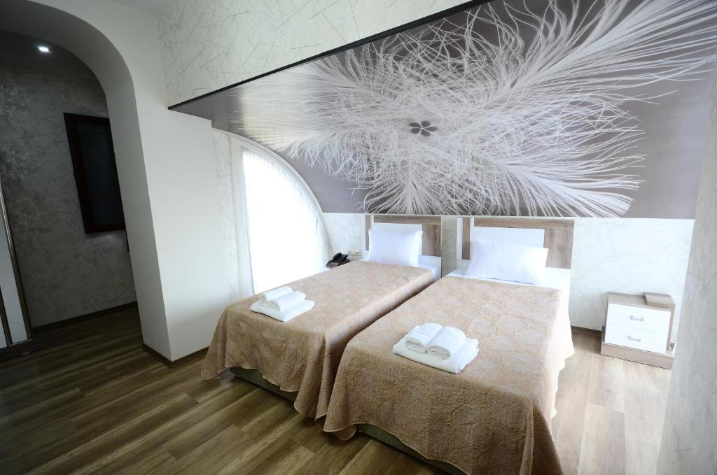 A bed or beds in a room at Dream Tower