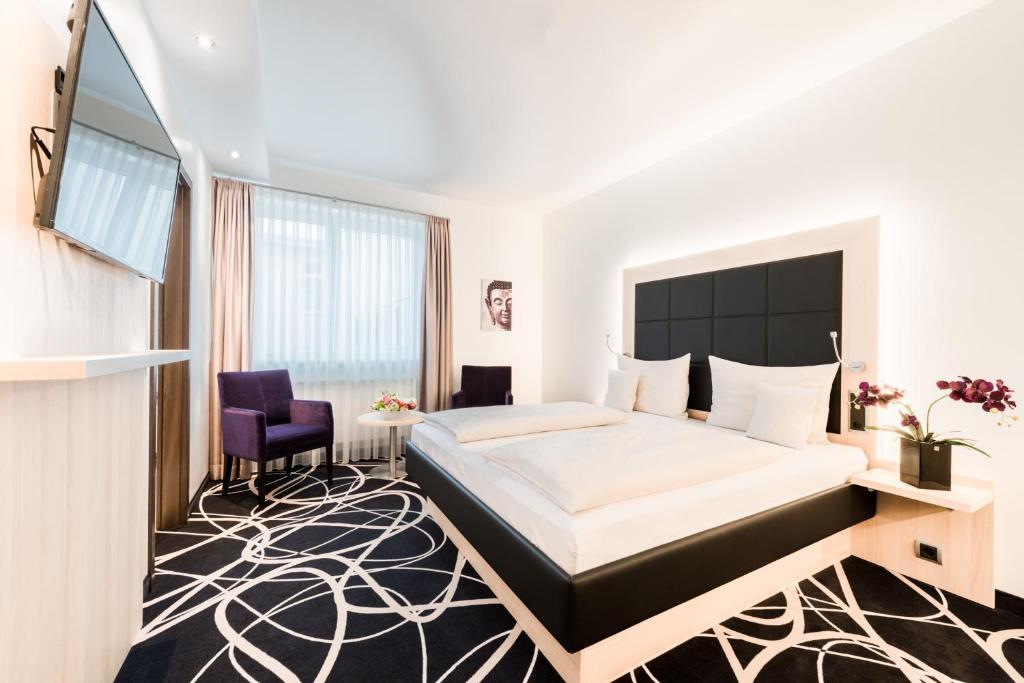 Ein Bett oder Betten in einem Zimmer der Unterkunft Bäder Park Hotel Sieben Welten Therme & Spa Resort