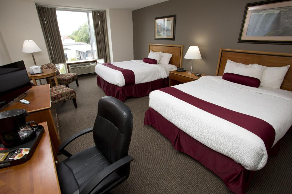 A bed or beds in a room at The Falls Hotel & Inn