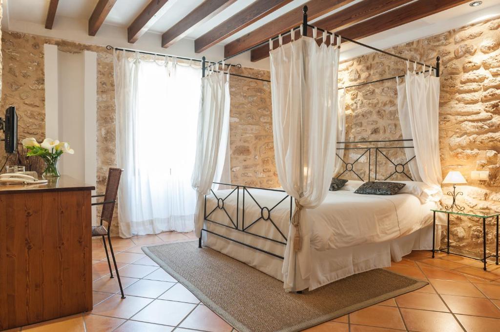 Cama o camas de una habitación en Hotel Can Simo