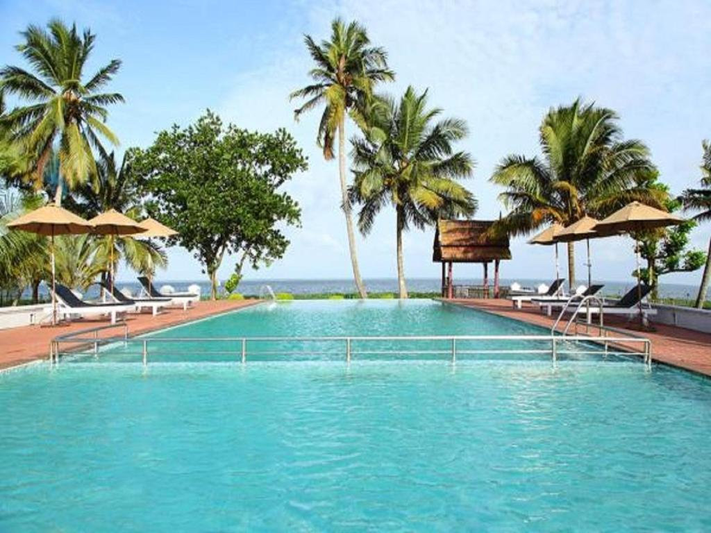 The swimming pool at or near Abad Whispering Palms