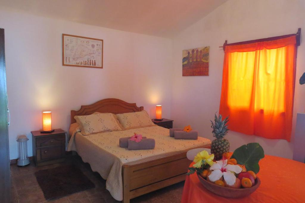 A bed or beds in a room at Cabañas Peretei