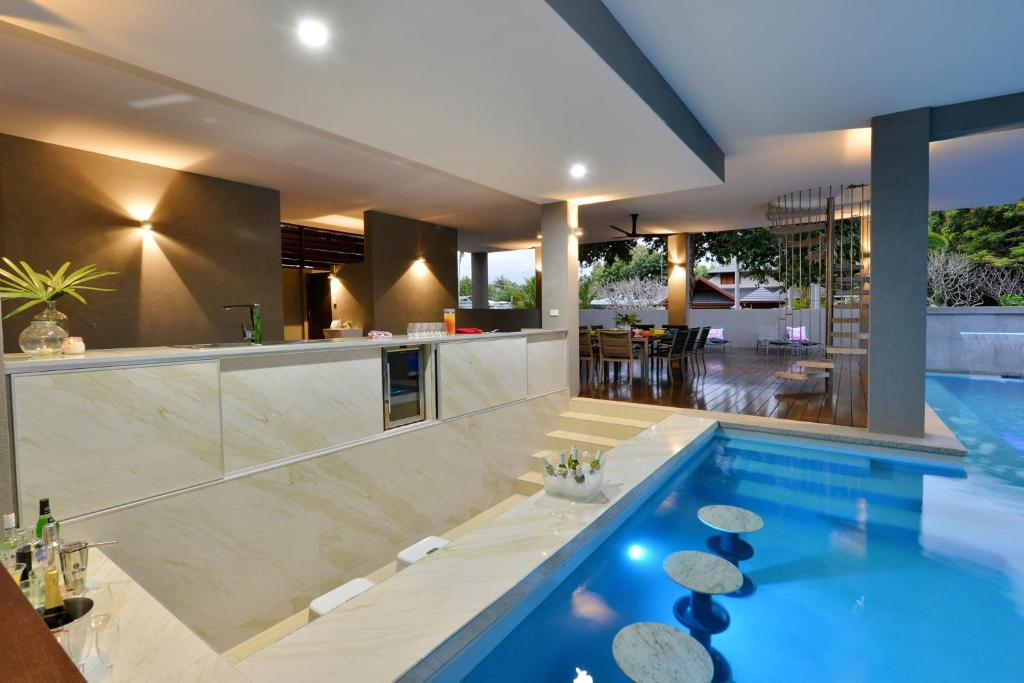The swimming pool at or near The Port Douglas Beach House
