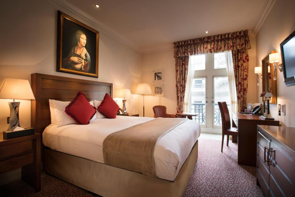 A bed or beds in a room at The Royal Horseguards