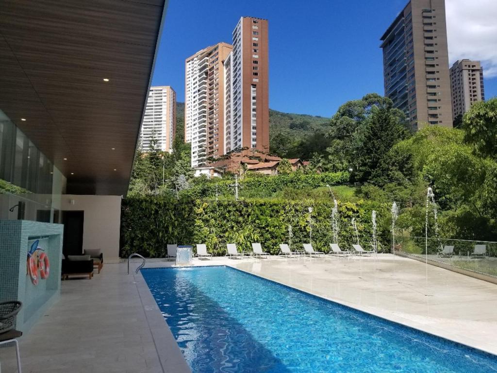 The swimming pool at or near Estelar La Torre Suites