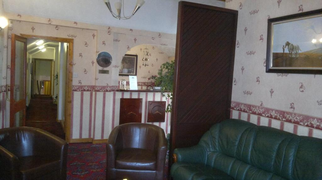The lobby or reception area at Town Clock B&B