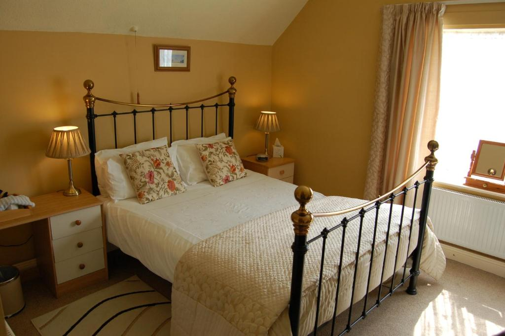 A bed or beds in a room at Compton House